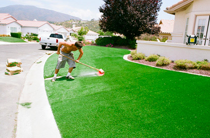 sweeping and skimming artificial grass